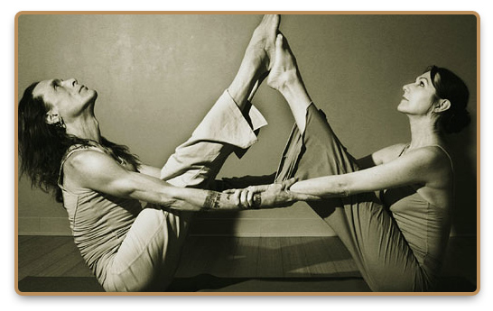 Man and woman practicing Jivamukti yoga together as a couple