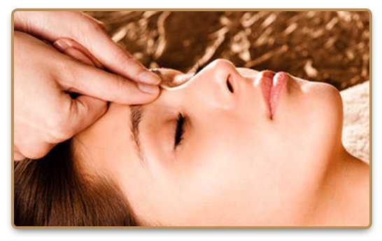Relaxed closed-eyed woman receiving Shiatsu massage