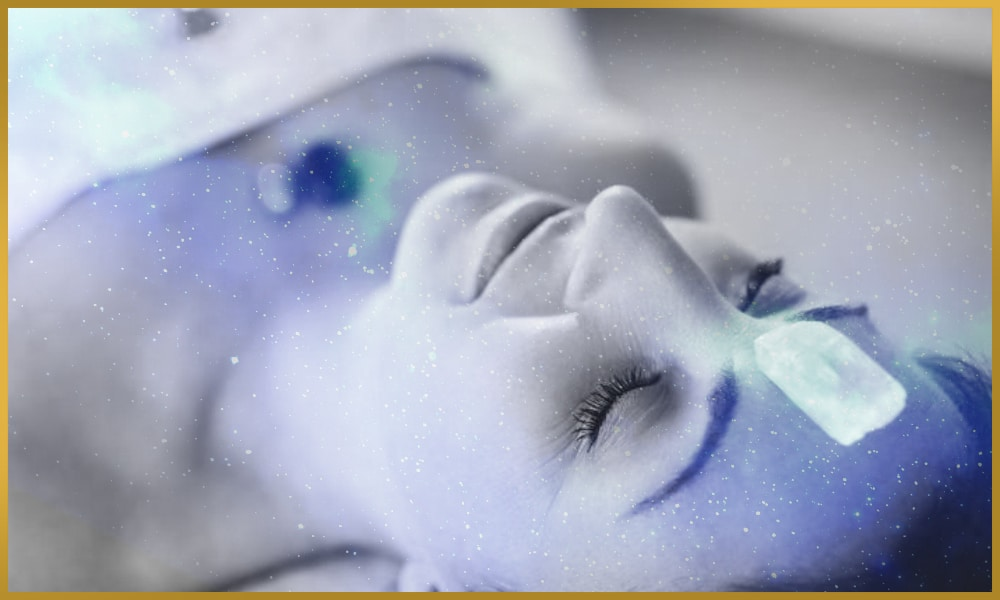 Smiling woman with crystals on her body during crystal healing