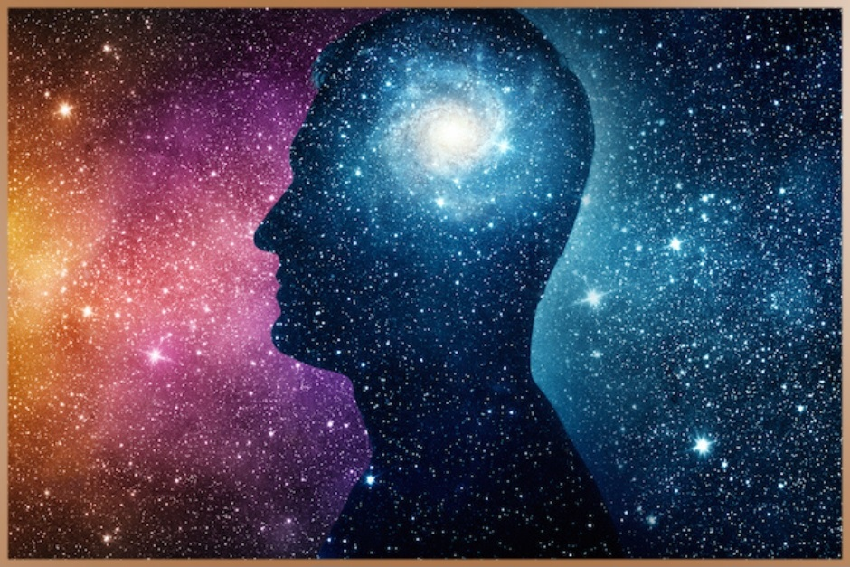 Male head shape with bright mind and starry sky background