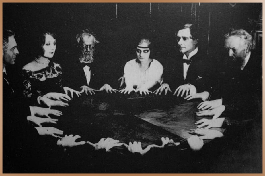 Group of people during a seance: an attempt to communicate with spirits.