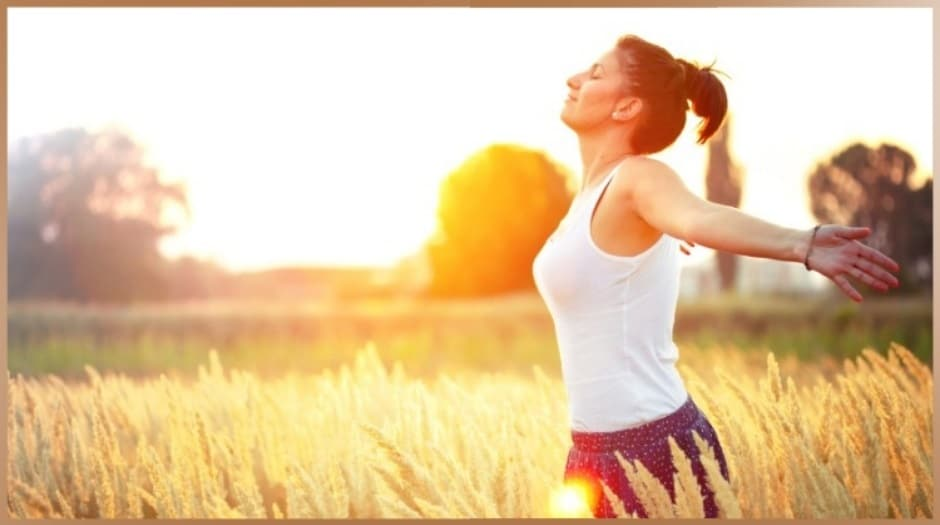 Healthy, sporty balanced woman in the nature at sunset