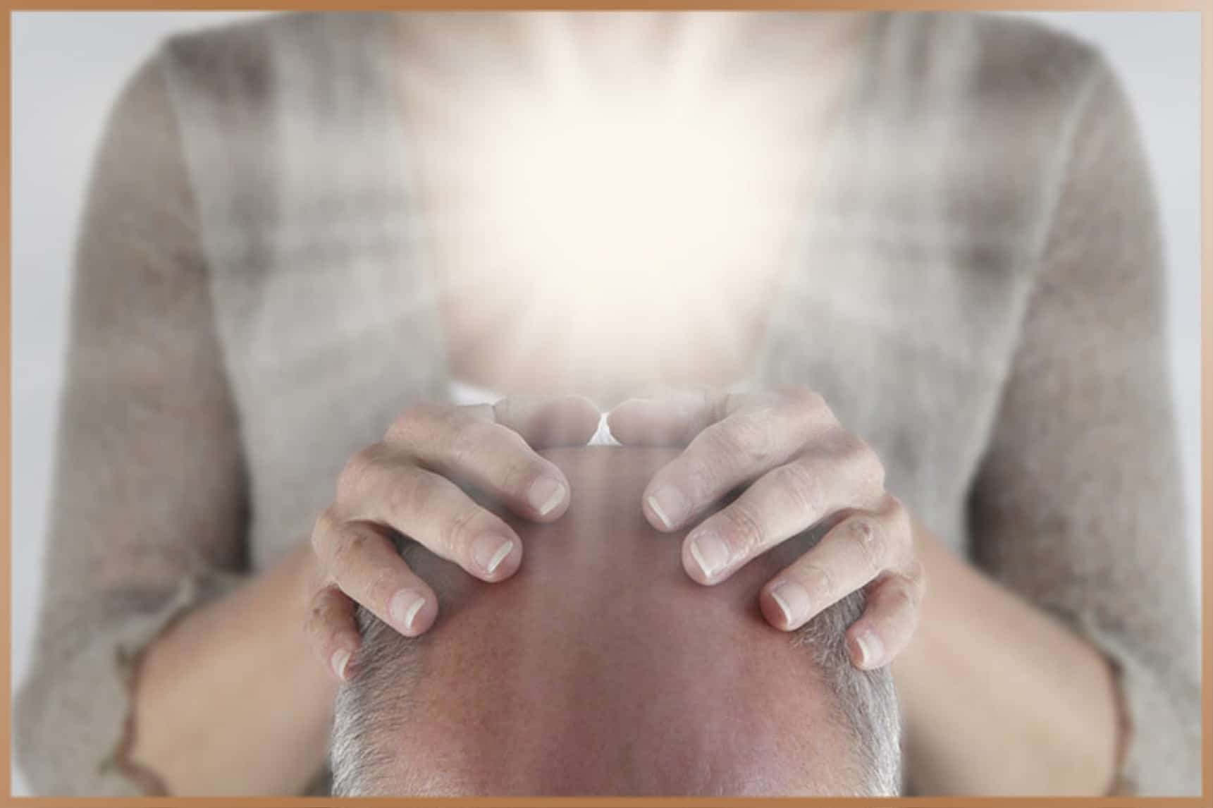 Woman gives Reiki energy healing to a man