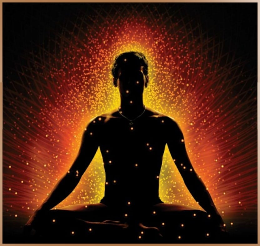 Figure of a meditating man with prana energy flowing in him