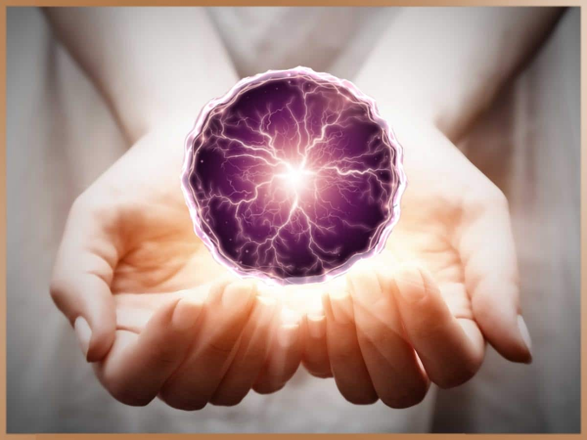 Purple psi ball for telekinesis in the hands of a woman
