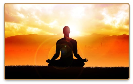 Figure of meditating man at sunset