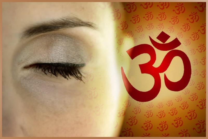 Women closes her eyes and focusing on Aum mantra