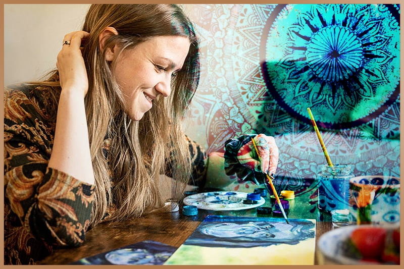 Woman creates art by painting