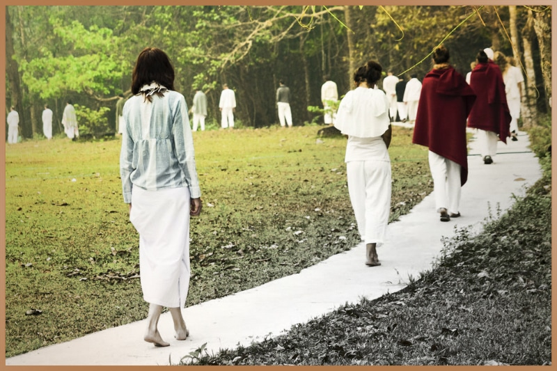 People practicing walking Vipassana meditation