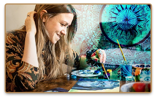 Happy and creative woman enjoying the joy of painting while making artwork