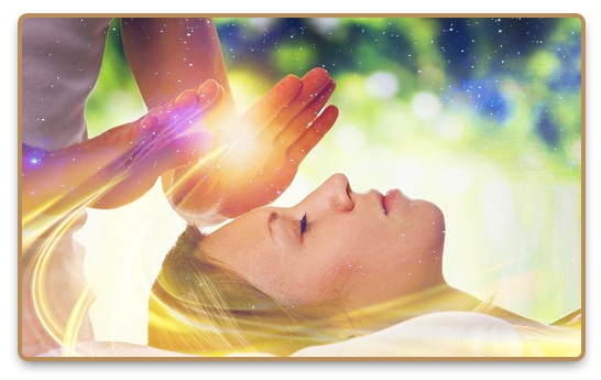 Energy Healing with hands on a laying women